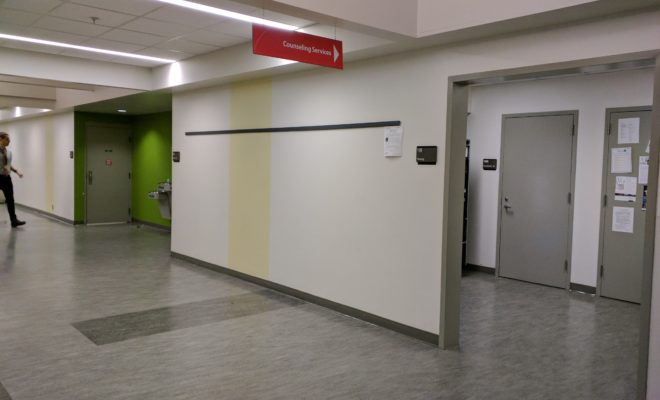 an empty hall with grey flooring