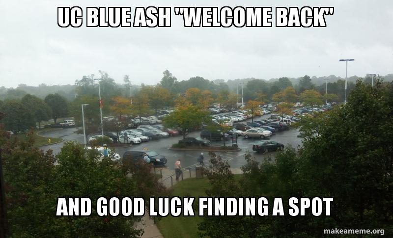 "Full UCBA parking lot with the words ""UCBA 'Welcome Back"" and ""Good Luck Finding a Space"""