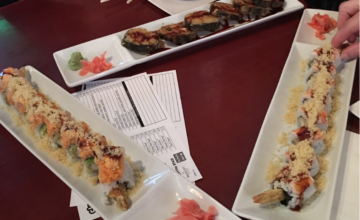 A table with plates of sushi