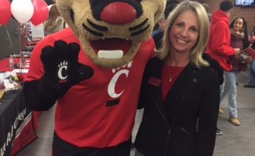 The Bearcat mascot with Monica Widdig