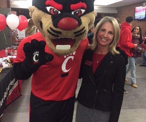 The Bearcat mascot with Monica Widdig