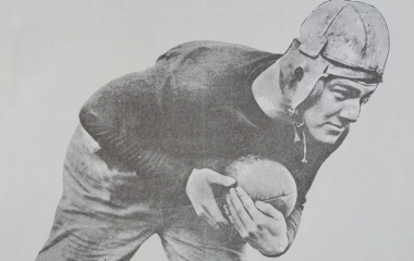 old photo of football player in position