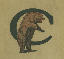 "bear stands on hind legs in front of letter ""c"""