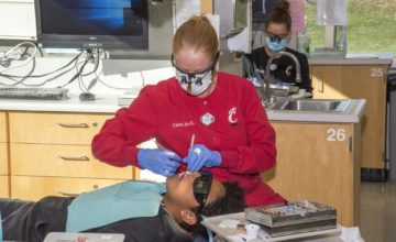 dental hygiene student treats patient
