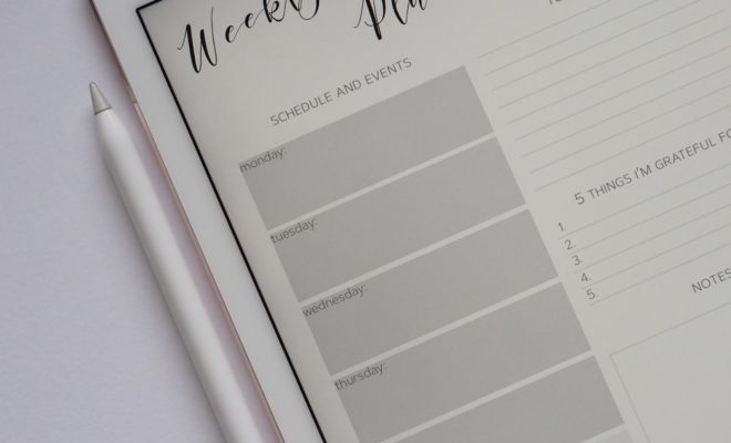 """Ipad with """"weekly planner"""" on the screen"""