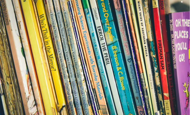 A photograph of a row of children's books on a shelf