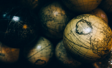 A photograph of a pile of globes