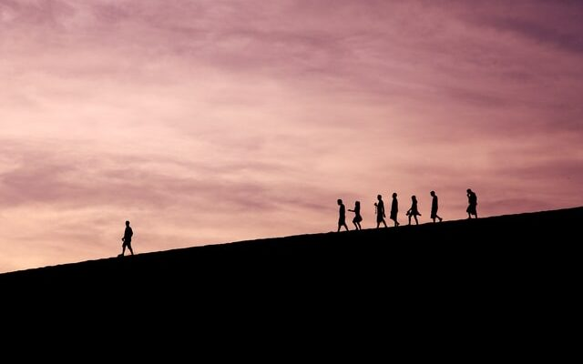Silhouette of people on a hill