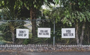 Signs with text: Don't give up; you are not alone; you matter